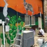 Magnano trabajando en el mural 2 de julio de 2015