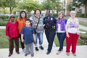 Officer Delta Jolly and neighbors during a National Night Out block party.